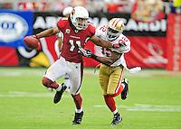 Sept. 13, 2009; Glendale, AZ, USA; San Francisco 49ers safety Michael Lewis tackles Arizona Cardinals wide receiver (11) Larry Fitzgerald at University of Phoenix Stadium. San Francisco defeated Arizona 20-16. Mandatory Credit: Mark J. Rebilas-