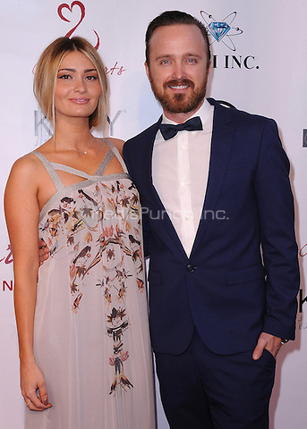 MALIBU, CA - MAY 10:  Lauren Parsekian and Aaron Paul at the 4th Annual Open Hearts Gala at a private residence on May 10, 2014 in Malibu, California. Credit: PGSK/MediaPunch