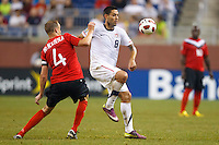 7 June 2011: Canada defender Kevin McKenna (4) and USA Men's National Team forward Clint Dempsey (8) go for the ball during the CONCACAF soccer match between USA and Canada at Ford Field Detroit, Michigan. USA won 2-0.