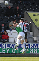 Matthew Doherty (left) and Steven Thompson go for the high ball in the St Mirren v Hibernian Clydesdale Bank Scottish Premier League match played at St Mirren Park, Paisley on 29.4.12. .