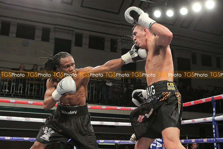 Craig Evans (black/green/white shorts) fights Ideh Ockuko in a Super-Featherweight at York Hall, Bethnal Green, London, promoted by Frank Warren - 01/11/12 - MANDATORY CREDIT: Gavin Ellis/TGSPHOTO - Self billing applies where appropriate - 0845 094 6026 - contact@tgsphoto.co.uk - NO UNPAID USE.