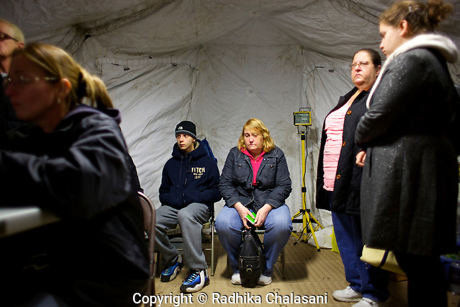 NEW DORP BEACH, NEW YORK-NOVEMBER 3: Residents wait to register for FEMA assistance after Hurricane Sandy at New Dorp High School November 3, 2012 in the Staten Island borough of New York City. Staten Island saw an influx of assistance today as it tries to recover from the devastating storm that left 19 dead on the island.