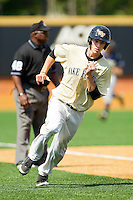 Evan Stephens #5 of the Wake Forest Demon Deacons hustles around third base to score a run against the Georgia Tech Yellow Jackets at Wake Forest Baseball Park on April 15, 2012 in Winston-Salem, North Carolina.  The Demon Deacons defeated the Yellow Jackets 11-3.  (Brian Westerholt/Four Seam Images)