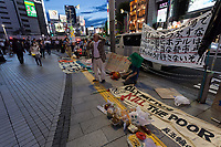 An older Japanese  man speaks at a small protest against the staging of the Olympic Games in Shinjuku, Tokyo, Japan Friday June 30th 2017. Though mostly popular with the Japanese population he staging of the 2020 Olympic Games in Tokyo is felt by some to be a waste of money when the economy is bad, causing increasing poverty rates and with problems in the Tsunami damaged North East coast still not fully resolved.