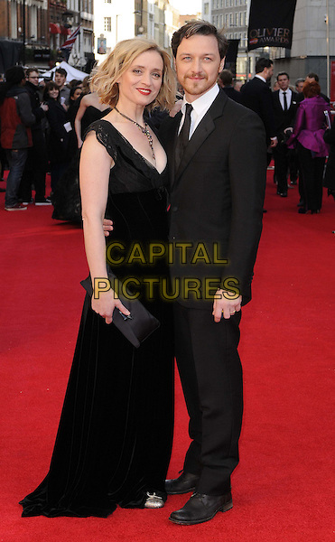 Anne-Marie Duff & James McAvoy.The Olivier Awards 2012, Royal Opera House, Covent Garden, London, England..April 15th, 2012.full length married husband wife black white suit dress necklace clutch bag facial hair beard.CAP/CAN.©Can Nguyen/Capital Pictures.