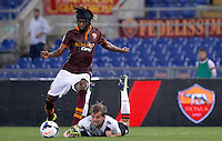 Calcio, Serie A: Roma vs Bologna. Roma, stadio Olimpico, 29 settembre 2013.<br /> AS Roma forward Gervinho, of Ivory Coast, left, kicks to score past Bologna defender Mikael Antonsson, of Sweden, during the Italian Serie A football match between AS Roma and Bologna at Rome's Olympic stadium, 29 September 2013.<br /> UPDATE IMAGES PRESS/Isabella Bonotto