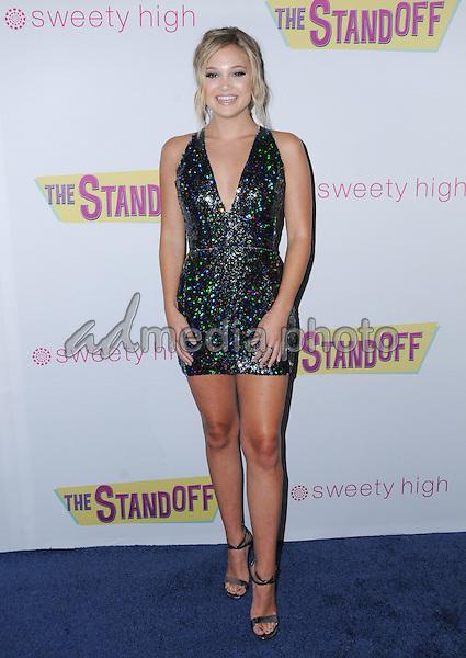 "08 September 2016 - Los Angeles, California. Olivia Holt. ""The Standoff"" Los Angeles premiere held at Regal LA Live. Photo Credit: Birdie Thompson/AdMedia"
