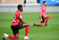 Lincoln City's Timothy Eyoma takes a knee in support of the Black Lives Matter movement<br /> <br /> Photographer Chris Vaughan/CameraSport<br /> <br /> The EFL Sky Bet League One - Saturday 12th September 2020 - Lincoln City v Oxford United - LNER Stadium - Lincoln<br /> <br /> World Copyright © 2020 CameraSport. All rights reserved. 43 Linden Ave. Countesthorpe. Leicester. England. LE8 5PG - Tel: +44 (0) 116 277 4147 - admin@camerasport.com - www.camerasport.com - Lincoln City v Oxford United