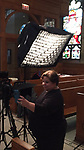 Filming at the Saint Vincent de Paul Parish Church for a retrospective video about Father Holtschneider's tenure at DePaul. (DePaul University/Jamie Moncrief)
