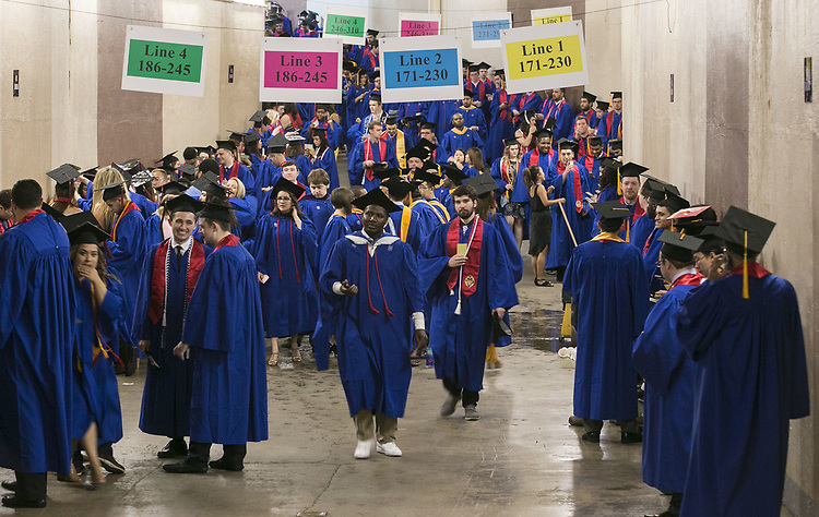 Students from the DePaul University College of Computing and Digital Media and the College of Communication fill the hallways inside the Allstate Arena Sunday, June 11, 2017, before the 119th commencement ceremonies in Rosemont, IL.