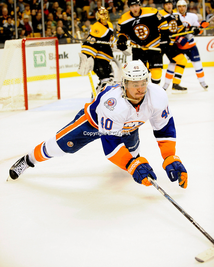 New York Islanders right wing Michael Grabner (40) dives for the puck in the Bruins zone during third period game action from Monday's game at TD Garden.