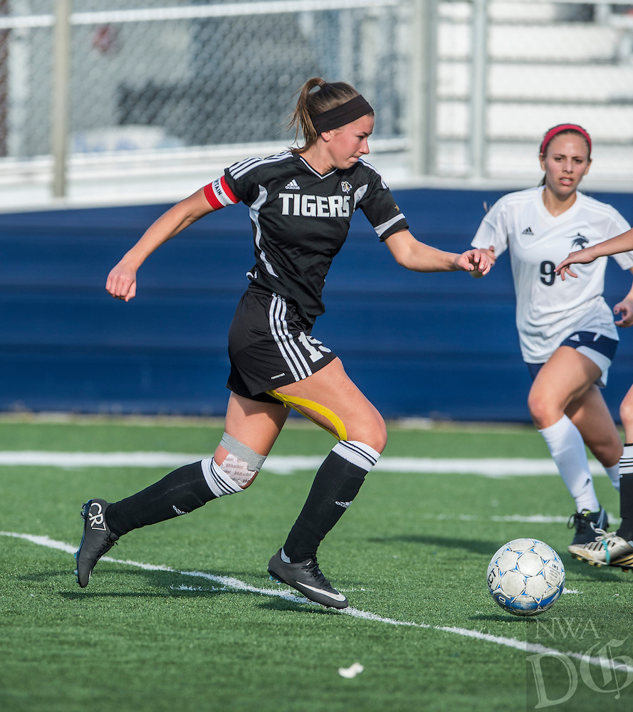 NWA Democrat-Gazette/ANTHONY REYES • @NWATONYR<br /> McKenzie Dixon, Bentonville senior, drives the ball on the pitch against Har-Ber Tuesday, May 5, 2015 at Wildcat Stadium in Springdale.