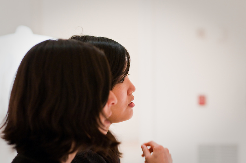 Two women looking during the University of Washington Master of Fine Art Thesis exhibition. Photograph biy Robert Wade.