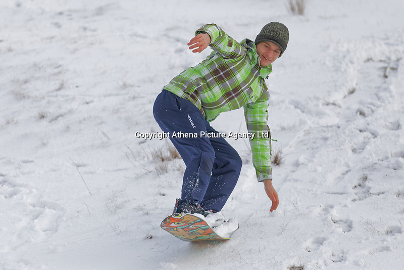 WEATHER PICTURE WALES<br /> Pictured: A young man makes the most of the snow as he snowboards down a slope on the Black Mountains near Brynamman, Wales, UK. Wednesday 23 January 2019