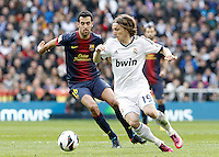Real Madrid's Luca Modrid (r) and FC Barcelona's Sergio Busquets during La Liga match.March 02,2013. (ALTERPHOTOS/Acero) /NortePhoto
