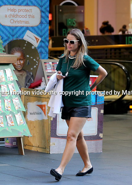 20 NOVEMBER  2013 SYDNEY AUSTRALIA<br /> <br /> EXCLUSIVE PICTURES<br /> <br /> A fresh faced make up free and pregnant Jodi Anasta pictured doing some shopping in Sydney city. Jodi was in a great mood as she walked into Pitt Street Mall for some retail therapy at Myer. Jodi wore a somewhat unflattering bottle green t-shirt with some leather looking shorts and flat shoes. On her way out of Myer Jodi brushed past the World Vision Child Sponsorship volunteer - obviously wanting to be on time to meet Braith who had done some shopping of his own. <br /> <br /> *No internet without clearance*.<br /> MUST CALL PRIOR TO USE <br /> +61 2 9211-1088. <br /> <br /> Matrix Media Group.Note: All editorial images subject to the following: For editorial use only. Additional clearance required for commercial, wireless, internet or promotional use.Images may not be altered or modified. Matrix Media Group makes no representations or warranties regarding names, trademarks or logos appearing in the images.
