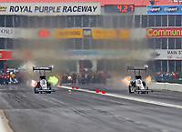 Apr 21, 2018; Baytown, TX, USA; NHRA top fuel driver Leah Pritchett (left) races alongside Tony Schumacher during qualifying for the Springnationals at Royal Purple Raceway. Mandatory Credit: Mark J. Rebilas-USA TODAY Sports