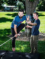 Owner of Rocky Mountain Slackline Dakota Collins (right), works with The Adventurist columnist, Clint Carter at Spring Park in Ft. Collins, Colorado, Sunday, August 27, 2017. Carter take on a vertigo-inducing highline&nbsp;that stretches across a traverse after only 4 days of training.<br /> <br /> Photo by Matt Nager
