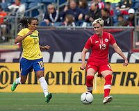 Canadian midfielder Sophie Schmidt (13) passes the ball as Brazilian player Marta (10) closes. In an international friendly, Canada defeated Brasil, 2-1, at Gillette Stadium on March 24, 2012.