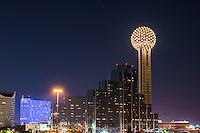 Took this of the photo of the Dallas cityscape as the building were lighting up with the modern architecture of the Hyatt Regency Dallas with the Reunion Tower along with the colorful Omni  in view in the downtown photo of the city at night.