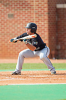 Richard Carter (10) of the Coastal Carolina Chanticleers squares to bunt against the High Point Panthers at Willard Stadium on March 15, 2014 in High Point, North Carolina.  The Chanticleers defeated the Panthers 1-0 in the first game of a double-header.  (Brian Westerholt/Four Seam Images)