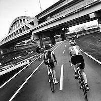 Cycling along the bike path beside the Keelung River, Taipei, Taiwan.