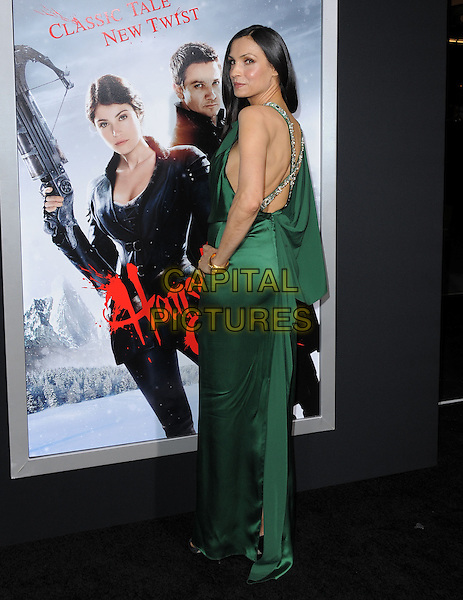 Famke Janssen.attending the Paramount Los Angeles film premiere of 'Hansel and Gretel: Witch Hunters', held at The Grauman's Chinese Theater in Hollywood, California, USA, January 24th 2013..full length green silk satin dress hand on hip straps cross over back rear behind silver  beaded clutch bag looking   long maxi                                .CAP/DVS.©Debbie VanStory/Capital Pictures.
