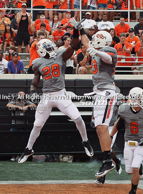 Oklahoma State Cowboys safety Deion Imade (28) and Oklahoma State Cowboys safety Zack Craig (23) in action during the game between the Louisiana-Lafayette Ragin Cajuns and the Oklahoma State Cowboys at the Boone Pickens Stadium in Stillwater, OK. Oklahoma State defeats Louisiana-Lafayette 61 to 34.