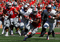 Ohio State Buckeyes wide receiver K.J. Hill (14) is pursued by UNLV Rebels linebacker Farrell Hester II (53) during the first quarter of Saturday's NCAA Division I football game at Ohio Stadium in Columbus on September 23, 2017. [Barbara J. Perenic/Dispatch]