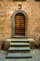This is a classic wooden door in Civita di Bagnoregio, Italy in Umbria.