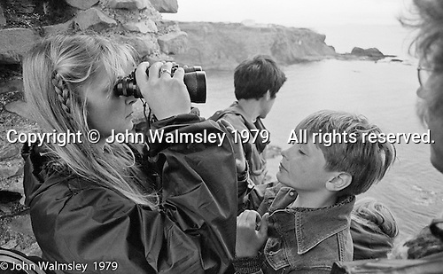 Kids from Wester Hailes taken by Youth Workers on a visit to Tatallon Castle near Dunbar, East Lothian, Scotland, 1979.  John Walmsley was Photographer in Residence at the Education Centre for three weeks in 1979.  The Education Centre was, at the time, Scotland's largest purpose built community High School open all day every day for all ages from primary to adults.  The town of Wester Hailes, a few miles to the south west of Edinburgh, was built in the early 1970s mostly of blocks of flats and high rises.