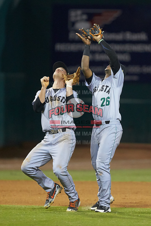 Augusta GreenJackets shortstop Manuel Geraldo (26) catches a pop fly over third baseman Jacob Gonzalez (18) during the game against the Greensboro Grasshoppers at First National Bank Field on April 10, 2018 in Greensboro, North Carolina.  The GreenJackets defeated the Grasshoppers 5-0.  (Brian Westerholt/Four Seam Images)