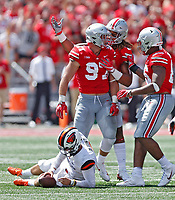 Ohio State Buckeyes defensive end Nick Bosa (97) celebrates his sack of Oregon State Beavers quarterback Conor Blount (2) with Ohio State Buckeyes defensive end Chase Young (2) in the 1st quarter at Ohio Stadium in Columbus, Ohio on September 1, 2018.  [Kyle Robertson/Dispatch]