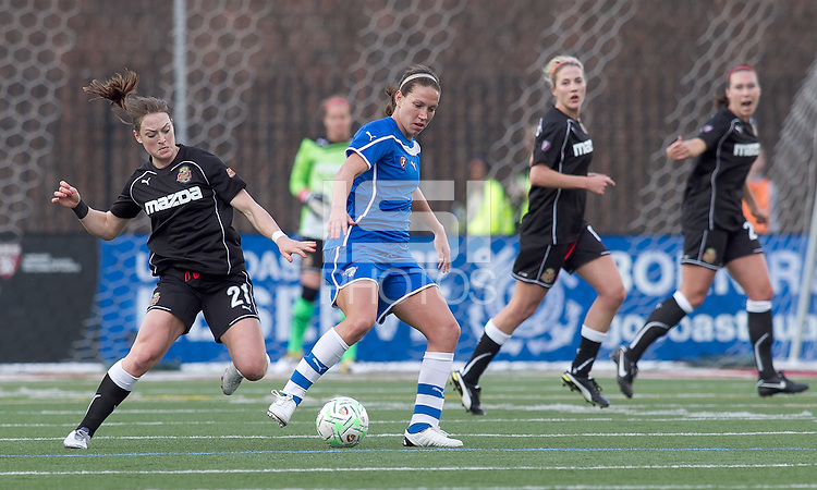 Boston Breakers forward Lauren Cheney (8) dribbles as Western New York Flash midfielder Brittany Bock (21) defends. In a Women's Professional Soccer (WPS) match, the Western New York Flash defeated the Boston Breakers, 2-1, at Harvard Stadium on April 17, 2011.