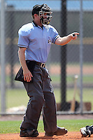 Umpire Brian Peterson makes a call during an extended spring training game between the Tampa Bay Rays and Baltimore Orioles at the Charlotte County Sports Park on April 28, 2012 in Port Charlotte, Florida.  (Mike Janes/Four Seam Images)