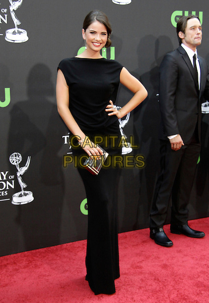 SHELLY HENNIG .36th Annual Daytime Emmy Awards held  at  The Orpheum Theatre, Los Angeles, California, USA, .30th August 2009..emmys full length black dress hand on hip long maxi clutch bag silver bracelet.CAP/ADM/TC.©T. Conrad/AdMedia/Capital Pictures.