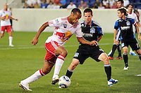 Thierry Henry (14) of the New York Red Bulls is defended by Sam Cronin (4) of the San Jose Earthquakes. The New York Red Bulls defeated the San Jose Earthquakes 2-0 during a Major League Soccer (MLS) match at Red Bull Arena in Harrison, NJ, on August 28, 2010.