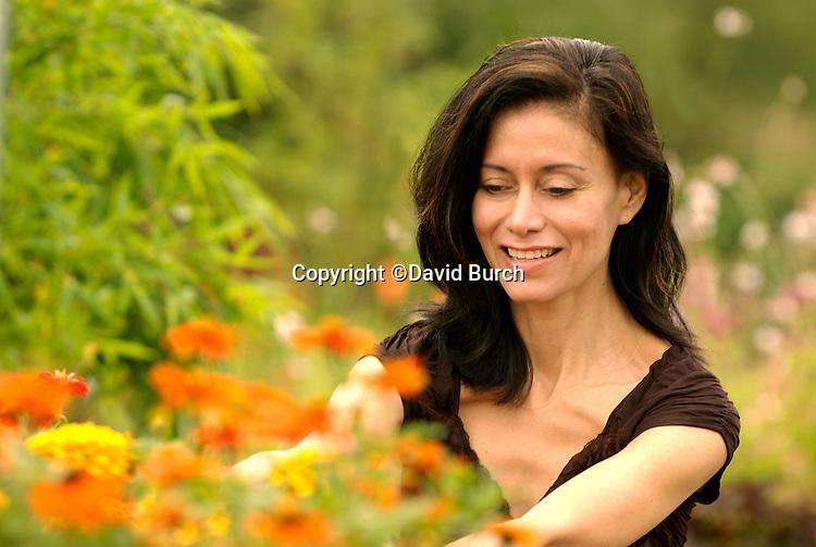 Hispanic woman in landscape nursery