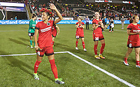 Portland, Oregon - Saturday July 2, 2016: Portland Thorns FC forward Nadia Nadim (9) waves to the crowd after the match during a regular season National Women's Soccer League (NWSL) match at Providence Park.