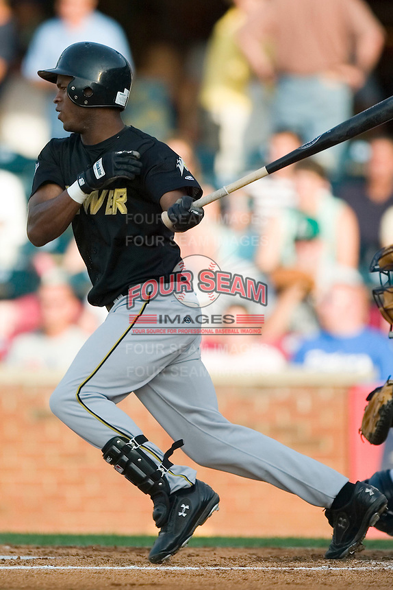 West Virginia right fielder Chuck Caufield (20) follows through on his swing versus Lexington at Applebee's Park in Lexington, KY, Thursday, June 7, 2007.