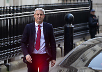 Stephen Barclay, Secretary of State for Exiting the European Union, leaves Downing Street to go to Parliament for PMQ's. There is a glow on his trousers from the car brake light.