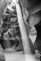 The upper Antelope Canyon is a great place to visit if you are near Page Arizona.  These desert southwest slot canyons are beautiful and they have so many textures and this black and white pull them out beautifyly. The past years of  floods, wind, and rain have etched out these canyons over many years.  The sandstone have definate bands of layers and as the erosion occurs through the many flash floods and wind  blowing through out there narrow slots canyons the  walls become smooth as if someone was carving them.  It is a natural site created in nature but because of this feature so of the canyons in this area or no longer accessable as last I heard about canyon x.