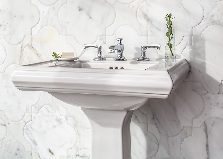 Mallorca Grande, a waterjet stone mosaic, shown in venetian honed Calacatta Tia, is part of the Miraflores Collection by Paul Schatz for New Ravenna.