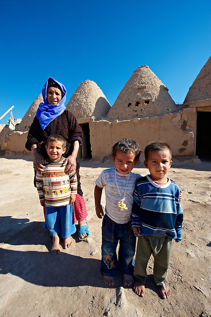 """Pictures of the beehive adobe buildings of Harran, south west Anatolia, Turkey.  Harran was a major ancient city in Upper Mesopotamia whose site is near the modern village of Altınbaşak, Turkey, 24 miles (44 kilometers) southeast of Şanlıurfa. The location is in a district of Şanlıurfa Province that is also named """"Harran"""". Harran is famous for its traditional 'beehive' adobe houses, constructed entirely without wood. The design of these makes them cool inside. 29"""