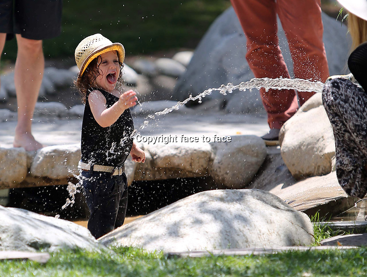 He is such a happy kid! Rachel Zoe's son Skyler makes a splash at Coldwater Canyon Park today. While Rodger_Berman kept it casual in the park, Rachel could not help but flaunt her inner fashionista: she wore her high heels even in the sandpit! Los Angeles, California on April 28, 2013 ..Credit: Vida/face to face