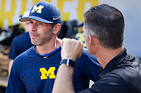 Michigan Wolverines assistant coach Nick Schnabel (23) before Game 1 of the NCAA College World Series Finals on June 24, 2019 at TD Ameritrade Park in Omaha, Nebraska. Michigan defeated Vanderbilt 7-4. (Andrew Woolley/Four Seam Images)