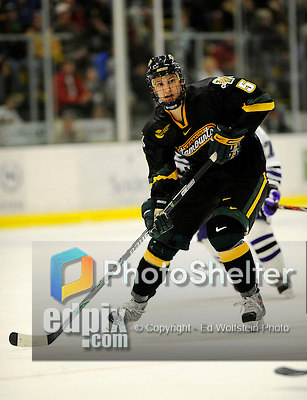 29 December 2007: University of Vermont Catamounts' forward Brayden Irwin, a Sophomore from Toronto, Ontario, in action against the Holy Cross Crusaders at Gutterson Fieldhouse in Burlington, Vermont. The Catamounts rallied in the final seconds of play to tie the game 1-1. After overtime, although the official result remained a tie game, the Cats moved up to the championship round by winning a sudden death shootout in the second game of the Sheraton/TD Banknorth Catamount Cup Tournament...Mandatory Photo Credit: Ed Wolfstein Photo