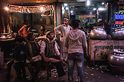 Customers wait for their orders at the biryani and kebab stall in Nizamuddin, New Delhi, India.