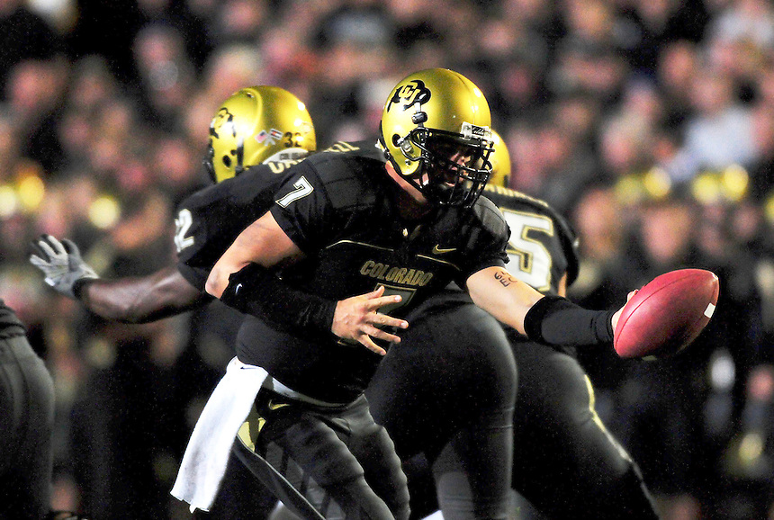 18 September 08: Colorado quarterback Cody Hawkins prepares a hand off against West Virginia. The Colorado Buffaloes defeated the West Virginia Mountaineers 17-14 in overtime at Folsom Field in Boulder, Colorado. For Editorial Use Only.