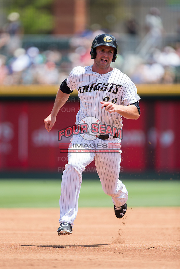 Matt Davidson (22) of the Charlotte Knights hustles towards third base against the Indianapolis Indians at BB&T BallPark on June 19, 2016 in Charlotte, North Carolina.  The Indians defeated the Knights 6-3.  (Brian Westerholt/Four Seam Images)